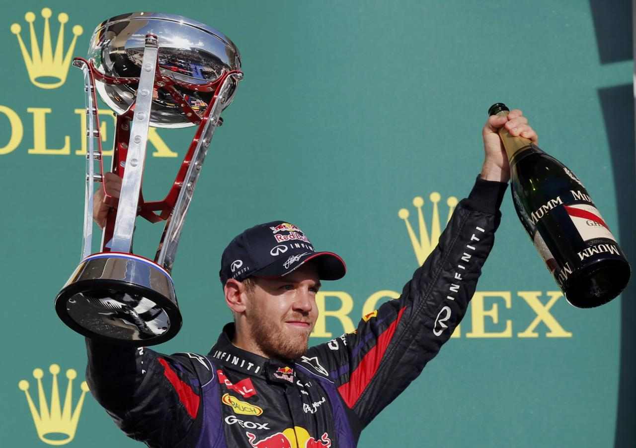 Red Bull Formula One driver Sebastian Vettel of Germany celebrates with his trophy on the podium after winning the Austin F1 Grand Prix at the Circuit of the Americas in Austin November 17, 2013. REUTERS/Adrees Latif (UNITED STATES - Tags: SPORT MOTORSPORT F1)