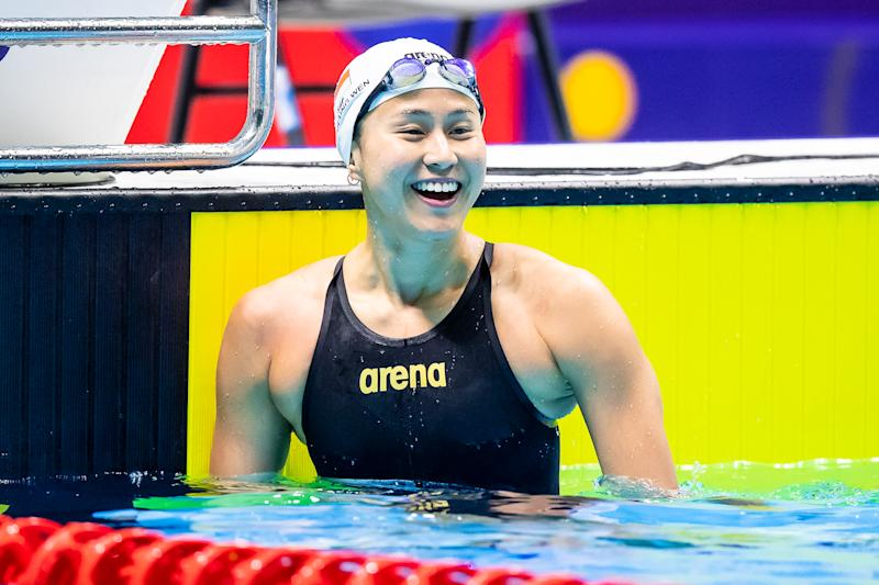 Singapore swimmer Quah Ting Wen smiles after winning gold in the women's 50m butterfly. (PHOTO SNOC/Andy Chua)