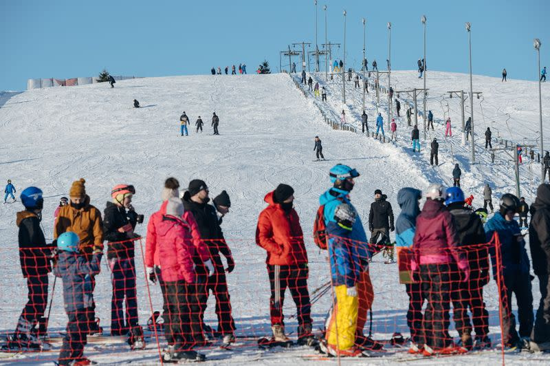 People queue to the ski lift after loosening of the coronavirus disease (COVID-19) restrictions in the reopened resort of Zakopane