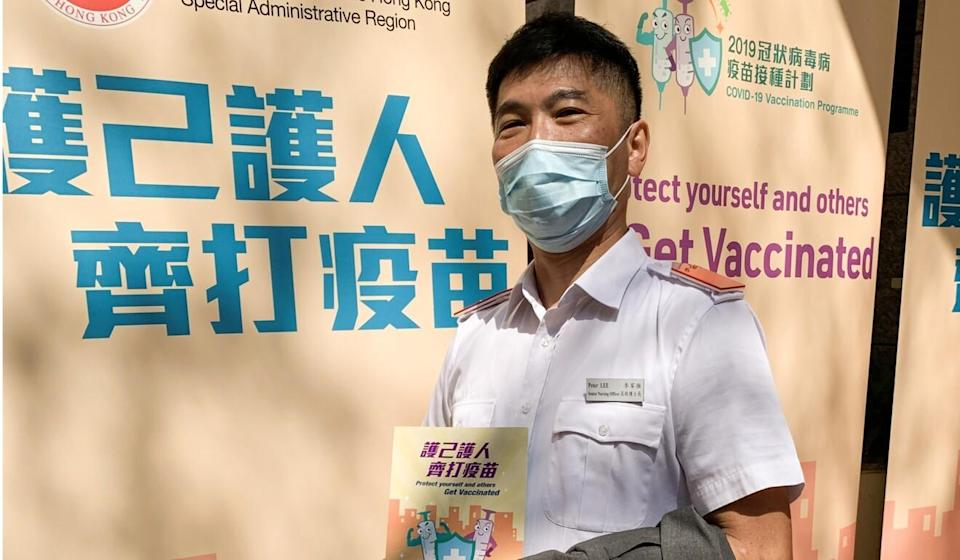 Peter Lee, a senior nursing officer, was among those who received a Covid-19 jab on Tuesday. Photo: Victor Ting