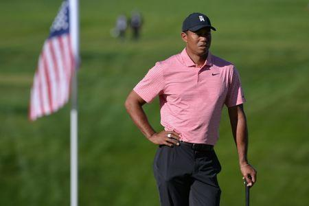 FILE PHOTO: Jan 27, 2019; San Diego, CA, USA; Tiger Woods looks on from the 13th green during the final round of the Farmers Insurance Open golf tournament at Torrey Pines Municipal Golf Course - South Course. Mandatory Credit: Orlando Ramirez-USA TODAY Sports