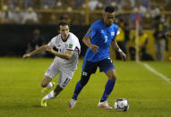 El Salvador's Darwin Ceren, right, is challenged by United States's Brenden Aaronson during a qualifying soccer match for the FIFA World Cup Qatar 2022 at Cuscatlan stadium in San Salvador, El Salvador, Thursday, Sept. 2, 2021. (AP Photo/Moises Castillo)