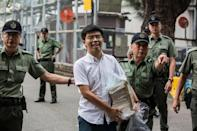 Hong Kong democracy activist Joshua Wong smiled as he walked free from prison in June