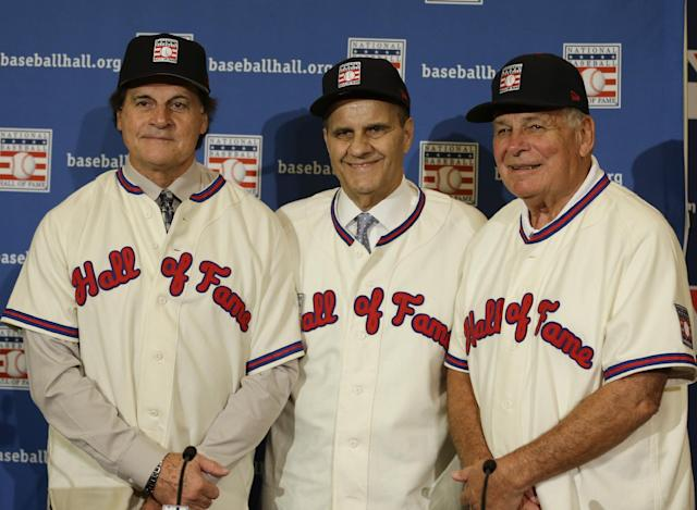 Retired managers, from left, Tony La Russa, Joe Torre and Bobby Cox gather for a photo after it was announced that they were unanimously elected to the baseball Hall of Fame during MLB winter meetings in Lake Buena Vista, Fla., Monday, Dec. 9, 2013.(AP Photo/John Raoux)