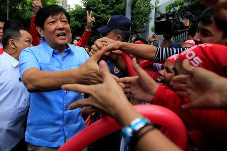 "Former senator Ferdinand ""Bongbong"" Marcos Jr and son of late former dictator Ferdinand Marcos is greeted by his supporters upon his arrival at the Supreme Court in metro Manila"