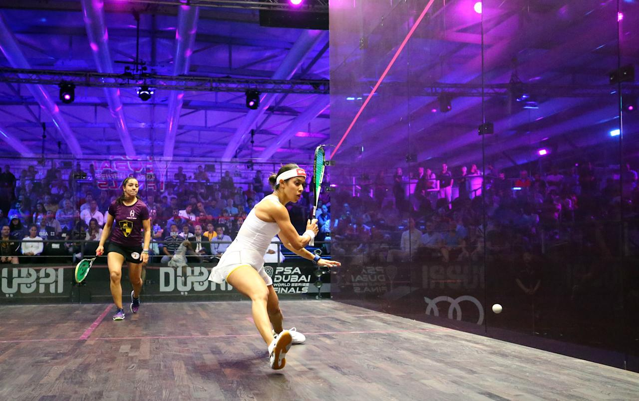 Nicol David (R) of Malaysia plays a backhand to Raneem el-Welily of Egypt during their semi-final match of the Dubai PSA World Series Finals squash tournament in Dubai on May 27, 2016. (AFP Photo/MARWAN NAAMANI)