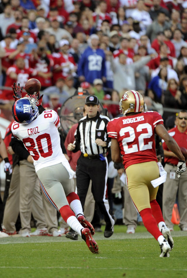 SAN FRANCISCO - NOVEMBER 13: Victor Cruz #80 of the New York Giants catches this thirty six yard pass over Carlos Rogers #22 of the San Francisco 49ers during an NFL football game at Candlestick Park November 13, 2011 in San Francisco, California. The 49ers won the game 27-20. (Photo by Thearon W. Henderson/Getty Images)