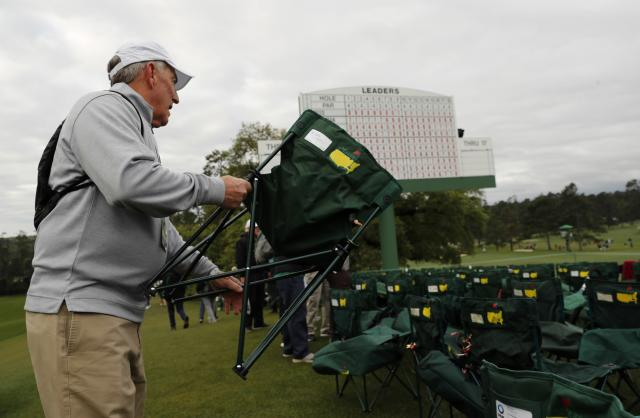 A golf patron places his chair during final round play of the 2018 Masters golf tournament at the Augusta National Golf Club in Augusta, Georgia, U.S. April 8, 2018. REUTERS/Jonathan Ernst