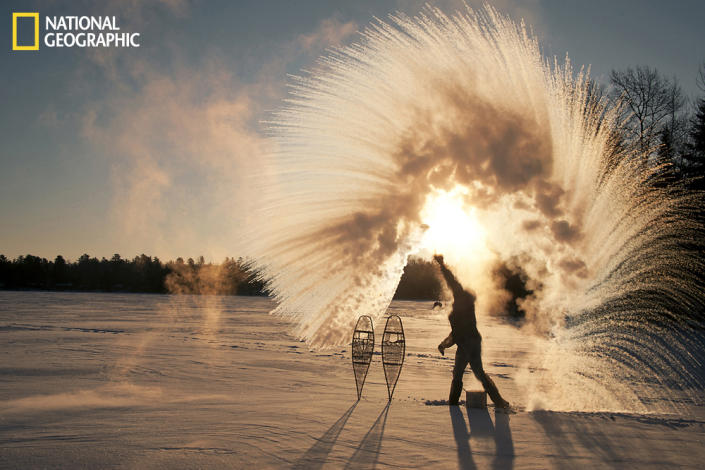 """With temperature swings of nearly 60ºF over several days, cold arctic air moves in over Ely, Minnesota. Toss a ladle of hot water into the frigid air and the water vaporizes instantly. A wonderful dance of physics and nature. Photograph taken on South Farm Lake on the edges of the Boundary Waters Canoe Area Wilderness. (Photo and caption Courtesy Layne Kennedy / National Geographic Your Shot) <br> <br> <a href=""""http://ngm.nationalgeographic.com/your-shot/weekly-wrapper"""" rel=""""nofollow noopener"""" target=""""_blank"""" data-ylk=""""slk:Click here"""" class=""""link rapid-noclick-resp"""">Click here</a> for more photos from National Geographic Your Shot."""