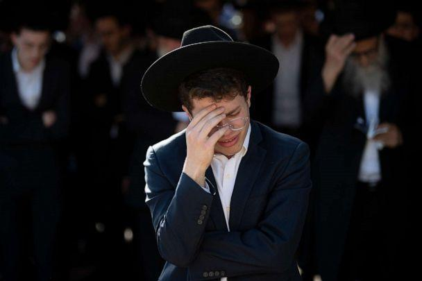 PHOTO: Ultra-Orthodox Jews mourn during the funeral of Moshe Ben Shalom at a cemetery in Petah Tikva, Israel, April 30, 2021. Shalom died in a stampede at a religious festival in Mt. Meron, northern Israel. (Oded Balilty/AP)