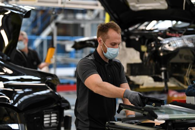 A worker assembles a car at the Mercedes-Benz plant in Sindelfingen, Germany as carmakers begin to bring plants back online after the shutdown. (Andreas Gebert/Anadolu Agency via Getty Images)