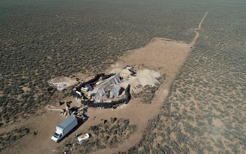 An aerial view of a makeshift compound is seen in the desert area of Amalia - Credit: Brian Skoloff/AP