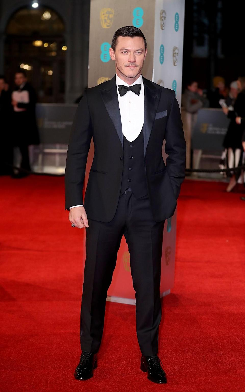 <p>The Welsh actor opted for the usual black tuxedo. <i>[Photo: Getty]</i> </p>