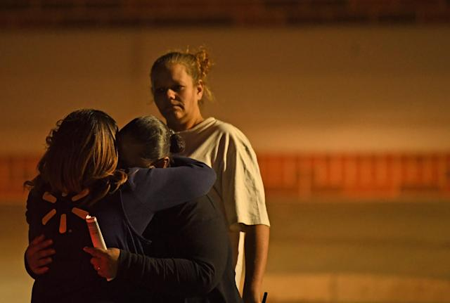 <p>Witnesses comfort each other outside the Thornton Police Station after two men are dead during a shooting inside the Walmart Super Center on Nov. 1, 2017 in Thornton, Colo. (Photo: RJ Sangosti/The Denver Post via Getty Images) </p>