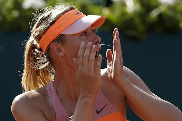 Russia's Maria Sharapova realizes she won the final of the French Open tennis tournament against Romania's Simona Halep at the Roland Garros stadium, in Paris, France, Saturday, June 7, 2014. Sharapova won in three sets 6-4, 6-7, 6-4. (AP Photo/Darko Vojinovic)