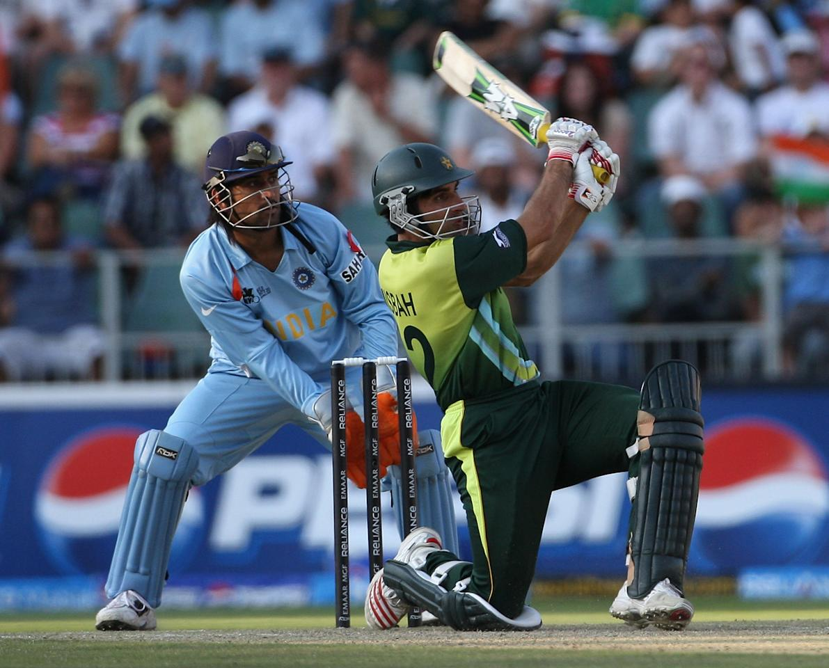 JOHANNESBURG, SOUTH AFRICA - SEPTEMBER 24:  Misbah-ul-Haq of Pakistan in action with MS Dhoni of India looking on during the Twenty20 Championship Final match between Pakistan and India at The Wanderers Stadium on September 24, 2007 in Johannesburg, South Africa.  (Photo by Hamish Blair/Getty Images)
