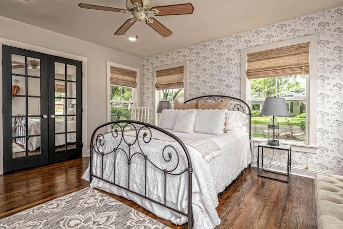 The master bedroom gets plenty of sun and has a spacious closet. (Carol Embry, Picture It Sold(R))