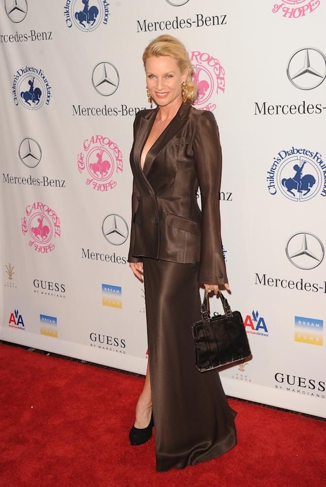 BEVERLY HILLS, CA - OCTOBER 20:  Actress Nicollette Sheridan arrives at the 26th Anniversary Carousel Of Hope Ball presented by Mercedes-Benz at The Beverly Hilton Hotel on October 20, 2012 in Beverly Hills, California.  (Photo by Jason Merritt/Getty Images)