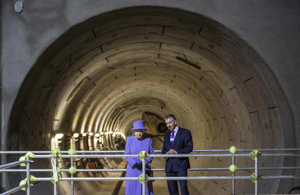 Britain's Queen Elizabeth and Mike Brown the London transport commissioner attend the formal unveiling of the new logo for Crossrail, which is to be named the Elizabeth line, at the construction site of the Bond Street station in central London, February 23, 2016.   REUTERS/Richard Pohle/Pool
