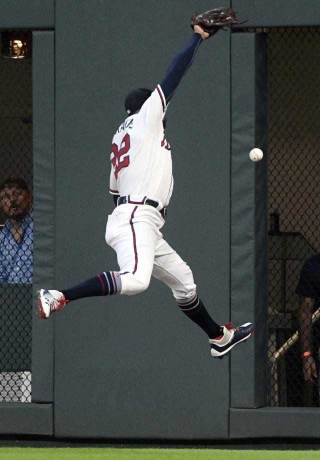 Atlanta Braves right fielder Nick Markakis cannot make a leaping catch in right field, allowing Los Angeles Dodgers' Chris Taylor a double during the fourth inning of a baseball game Friday, July 27, 2018, in Atlanta. (AP Photo/John Amis)