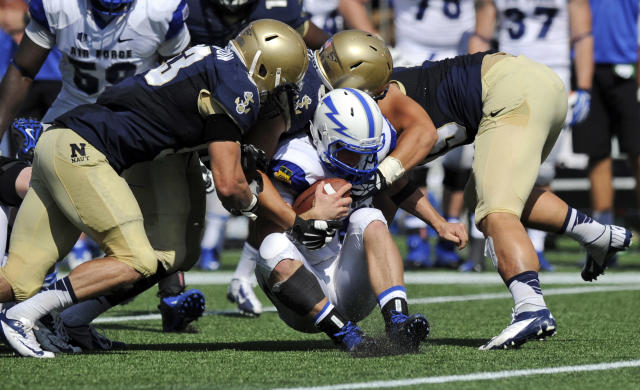 Navy linebacker Cody Peterson, left, and Evan Palelei, second from left, tackle Air Force quarterback Karson Roberts, bottom center, during the second half of an NCAA football game, Saturday, Oct. 5, 2013, in Annapolis, Md. Navy won 28-10. (AP Photo/Nick Wass)