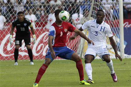 Costa Rica's Alvaro Saborio fights for the ball with Honduras' Maynor Figueroa during their 2014 World Cup qualifying soccer match at Olimpico stadium in San Pedro Sula