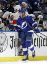 Tampa Bay Lightning left wing Ondrej Palat (18) pumps his fist after scoring against the Florida Panthers during the third period of an NHL hockey game Thursday, Oct. 3, 2019, in Tampa, Fla. (AP Photo/Chris O'Meara)