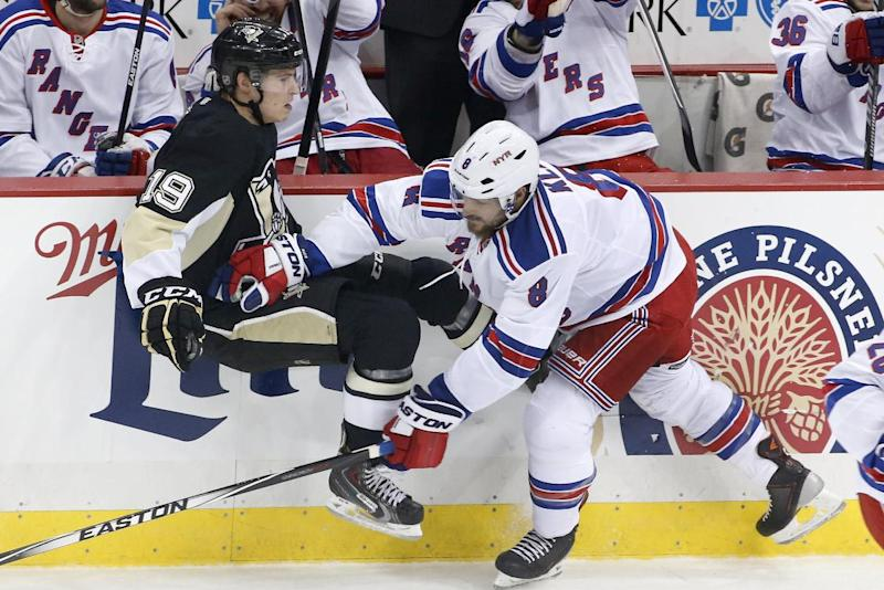 Pittsburgh Penguins' Beau Bennett (19) is checked off the puck by New York Rangers' Kevin Klein (8) in the first period of Game 5 of a second-round NHL playoff hockey series in Pittsburgh, Friday, May 9, 2014. (AP Photo/Gene J. Puskar)