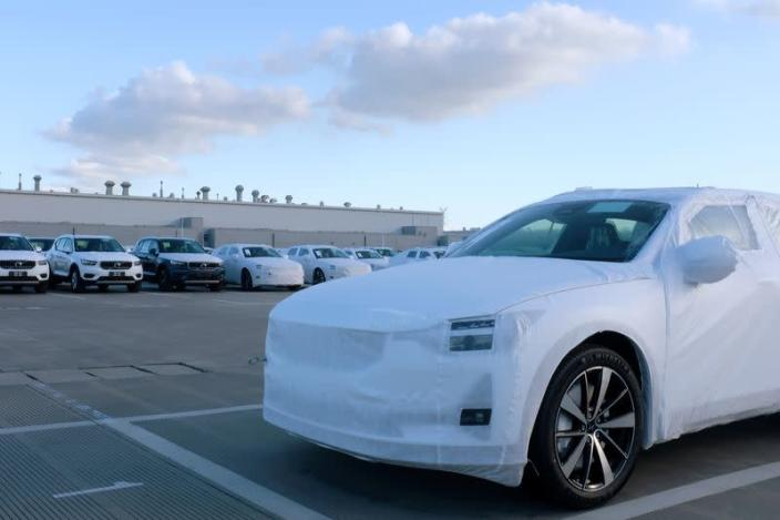 FILE PHOTO: Polestar electric vehicle for export is seen in front of Volvo sport utility vehicles at a Geely plant in Taizhou