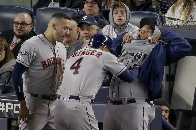 Houston Astros' George Springer (4) celebrates with Martin Maldonado, right, and Carlos Correa after hitting a three-run home run against the New York Yankees during the third inning of Game 4 of baseball's American League Championship Series, Thursday, Oct. 17, 2019, in New York. (AP Photo/Seth Wenig)