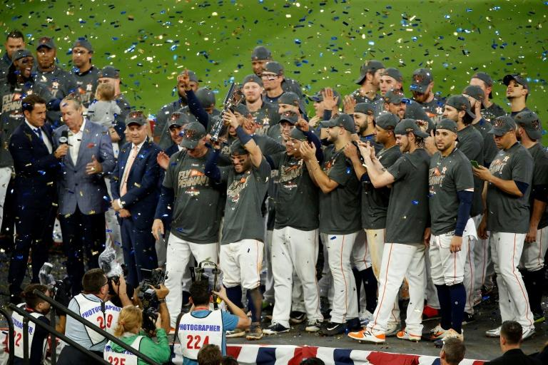 The Houston Astros celebrate after defeating the New York Yankees by a score of 4-0 to win Game Seven of the American League Championship Series at Minute Maid Park in Texas
