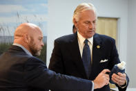South Carolina Gov. Henry McMaster, right, holds a bottle containing horseshoe crab blood, which is a vital component in the contamination testing of injectable medicines - including the coronavirus vaccines - with Foster Jordan of Charles River Labs on Friday, Aug. 6, 2021, in Charleston, S.C. (AP Photo/Meg Kinnard)