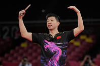 Ma Long of China makes a gesture after defeating Fan Zhendong of China during the gold medal match of the table tennis men's singles at the 2020 Summer Olympics, Friday, July 30, 2021, in Tokyo. (AP Photo/Kin Cheung)