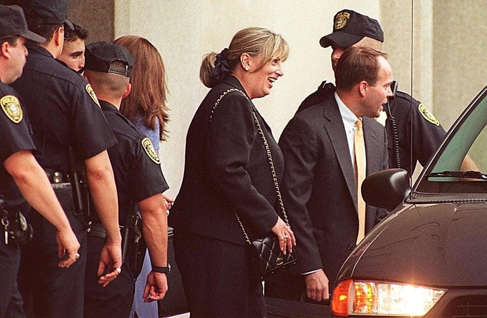 Linda Tripp, confidant to former White House intern Monica Lewinsky, leaves the US District Courthouse in Washington, DC on 30 June 1998 (JOYCE NALTCHAYAN/AFP via Getty Images)