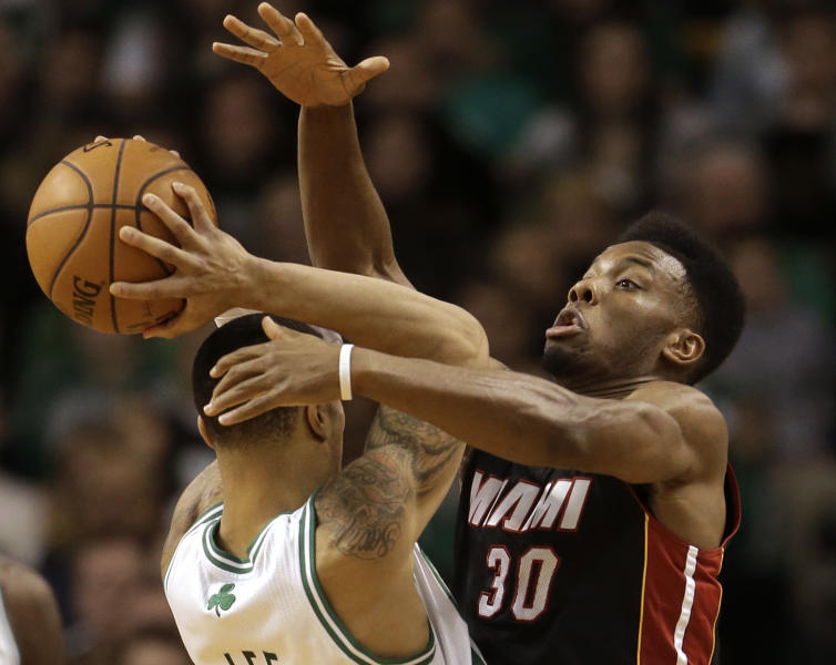 Boston Celtics shooting guard Courtney Lee, left, tries to drive past Miami Heat point guard Norris Cole (30), right, in the first half of an NBA basketball game at the TD Garden in Boston, Sunday, Jan. 27, 2013. (AP Photo/Steven Senne)