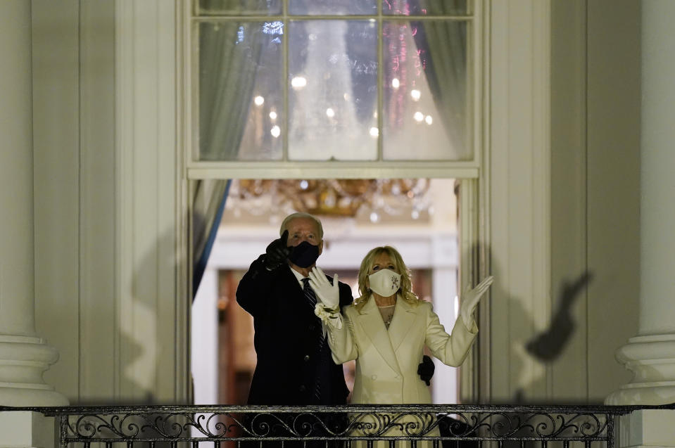 President Joe Biden and first lady Jill Biden watch fireworks light up the sky from the White House, Wednesday, Jan. 20, 2021, in Washington. (AP Photo/Evan Vucci)