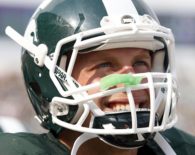 FILE - In this Sept. 7, 2013, file photo, Michigan State's Max Bullough watches from the sidelines during an NCAA college football game against South Florida in East Lansing, Mich. With a family history at Michigan State that stretches back decades, Bullough can provide a unique perspective on this week's showdown with rival Michigan. (AP Photo/Al Goldis, File)