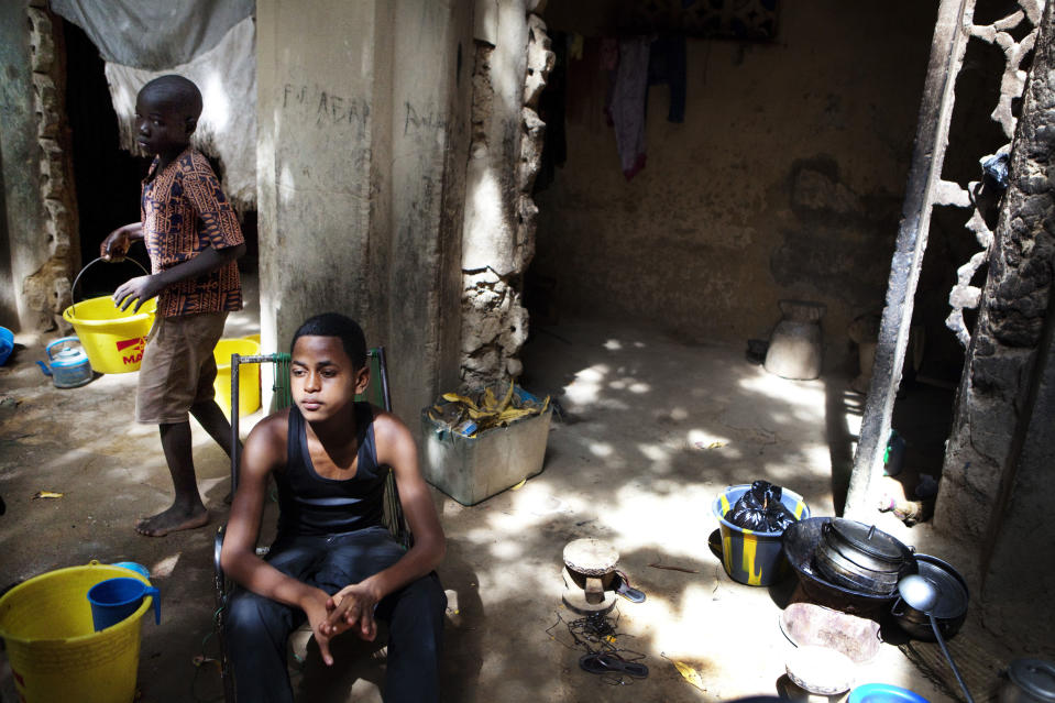 In this Thursday, Sept. 27, 2012 photo, Salif Haidara, 16, sits in the home of a friend in Mopti, Mali, where he has taken refuge after leaving his hometown in the country's Islamist-controlled north. Islamists offered Salif 15,000 francs ($30) a day for himself and 200,000 francs ($400) a month for his family to join them and become a 'holy warrior,' but he turned down the offer. Across northern Mali, Islamists have plucked and paid for as many as 1,000 children from rural towns and villages devastated by poverty and hunger, The Associated Press has found. Interviews conducted by the AP provide evidence that a new generation in what was long a moderate and stable Muslim nation is becoming radicalized, as the Islamists gather forces to fight a potential military intervention backed by the United Nations. (AP Photo)