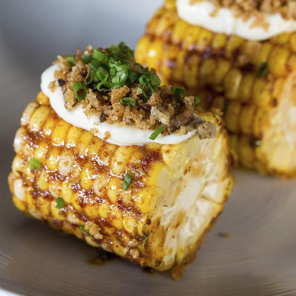"""<p>You'll never have corn the regular way again after trying this recipe, which calls for the veggie to be slathered in jerk butter and sprinkled with ranch breadcrumbs.</p><p><em><a href=""""https://www.womansday.com/food-recipes/a35141065/roasted-jerk-corn-recipe/"""" rel=""""nofollow noopener"""" target=""""_blank"""" data-ylk=""""slk:Get the Roasted Jerk Corn recipe."""" class=""""link rapid-noclick-resp"""">Get the Roasted Jerk Corn recipe.</a></em></p>"""
