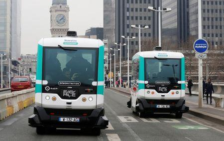 Two self-driving electric minibuses are seen on the 130-metre test route between Gare de Lyon and Austerlitz train stations in Paris