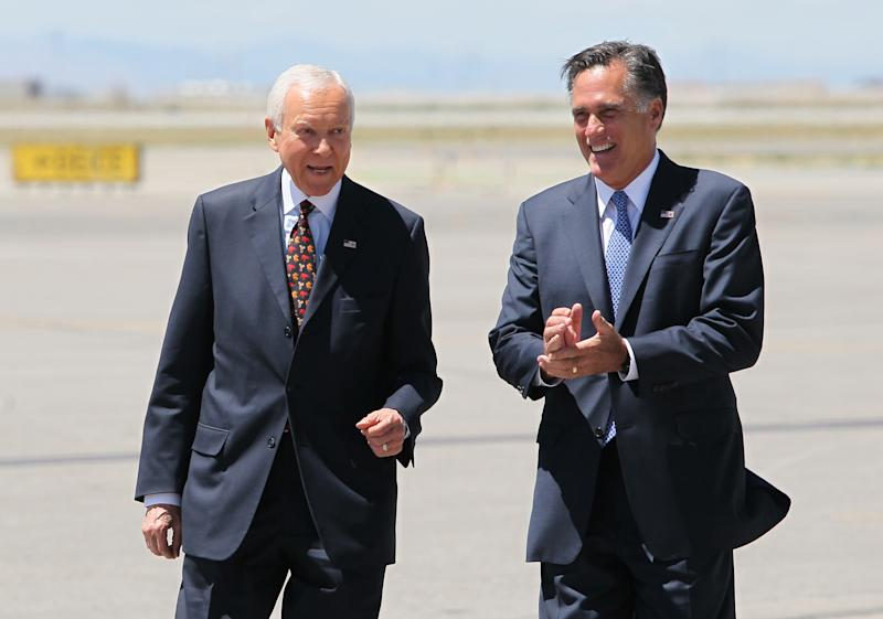 Republican presidential candidate and former Massachusetts Gov. Mitt Romney, right, laughs with U.S. Senator Orrin Hatch, R-Utah, as they walk on the tarmac at Salt Lake International Airport, Friday, June 8, 2012, in Salt Lake City. Romney is making a stop in the Beehive State for some fund raising events and to show his support for the 78-year-old, six term senator who is facing a tough primary election on June 26. (AP Photo/Colin E. Braley)