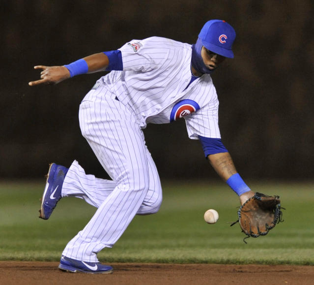Chicago Cubs shortstop Starlin Castro stops a grounder hit by Arizona Diamondbacks' Chris Owings (16), during the fifth inning of a baseball game in Chicago, Tuesday, April 22, 2014. (AP Photo/Paul Beaty)