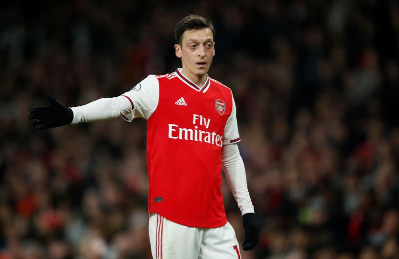 Arsenal must find a way to get Ozil involved again, says Wenger