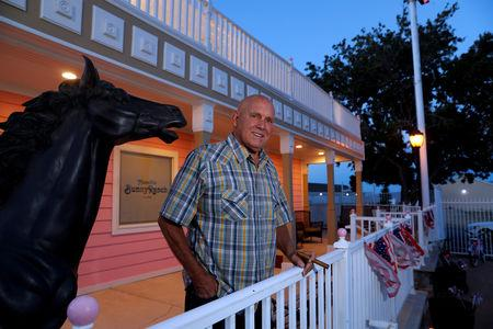 FILE PHOTO: Dennis Hof, owner of the Moonlite BunnyRanch legal brothel and recent winner of the Republican primary election for Nevada State Assembly District 36, poses outside the brothel in Mound House, Nevada, U.S. June 16, 2018. REUTERS/Steve Marcus/File Photo