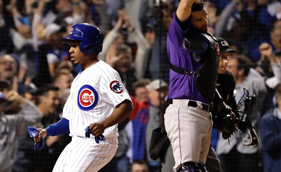 Terrance Gore did his best acting job to earn first base and save the Cubs' season before video replay showed definitively that he was not hit by a pitch. (AP)