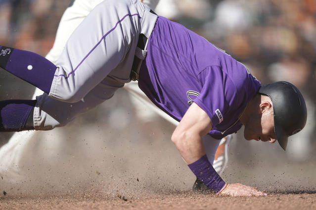 Colorado Rockies' Trevor Story slides into home plate after stealing third base against the San Francisco Giants during the eighth of a baseball game Thursday, Sept. 26, 2019, in San Francisco. (AP Photo/Tony Avelar)
