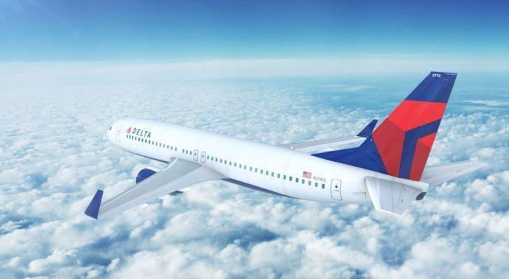 a Delta (DAL) plane flying through the clouds