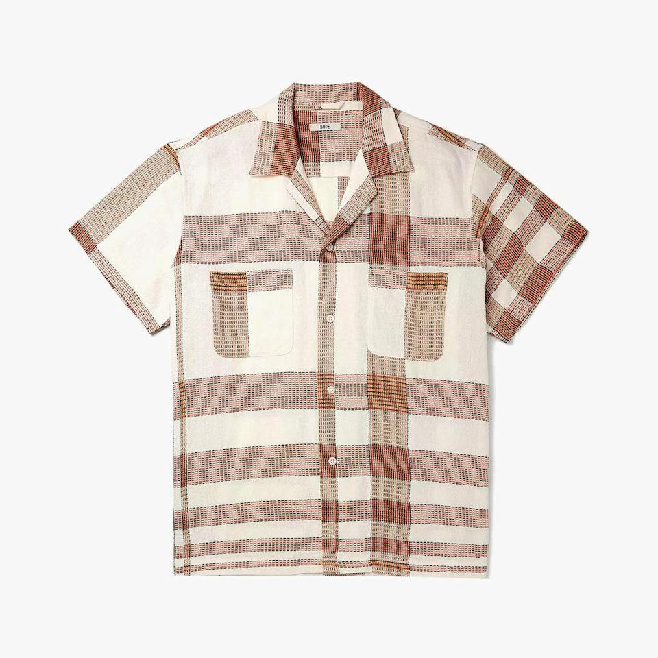 """$415, MR PORTER. <a href=""""https://www.mrporter.com/en-us/mens/product/bode/clothing/checked-shirts/camp-collar-checked-embroidered-linen-and-cotton-blend-shirt/17476499599761217"""" rel=""""nofollow noopener"""" target=""""_blank"""" data-ylk=""""slk:Buy Now"""" class=""""link rapid-noclick-resp"""">Buy Now</a><br>"""