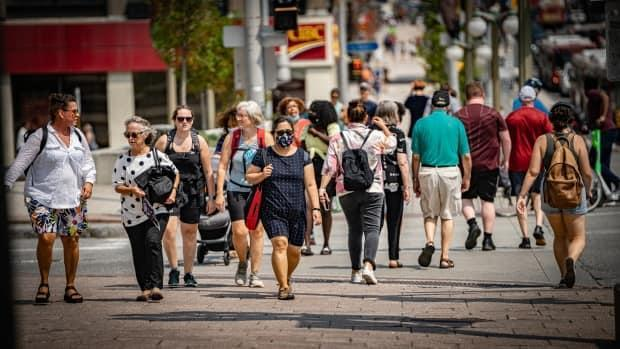 People make their way through downtown Ottawa on a warm day earlier this summer. Public health officials reported another 37 COVID-19 cases Saturday. (Brian Morris/CBC - image credit)