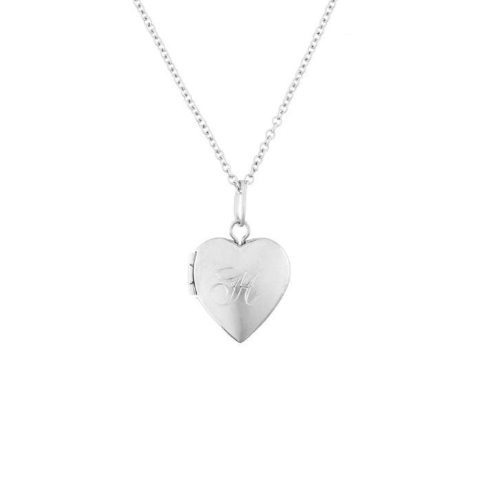 "<h3>Catbird Dollhouse Heart Locket</h3> <br>This dainty locket makes for a sweet, sentimental gift that any new mom will look forward to wearing every day. Engrave it with her child's initial, and use Catbird's <a href=""https://www.catbirdnyc.com/files/locket_template.pdf"" rel=""nofollow noopener"" target=""_blank"" data-ylk=""slk:handy template"" class=""link rapid-noclick-resp"">handy template</a> to crop the photo. <em>Voilà</em>, the perfect jewelry present.<br><br><strong>Catbird Jewelry</strong> Dollhouse Heart Locket, Silver, $, available at <a href=""https://go.skimresources.com/?id=30283X879131&url=https%3A%2F%2Fwww.catbirdnyc.com%2Fdollhouse-heart-locket-silver.html"" rel=""nofollow noopener"" target=""_blank"" data-ylk=""slk:Catbird"" class=""link rapid-noclick-resp"">Catbird</a><br>"